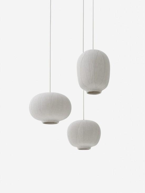 布を重ね合わせることで複雑な陰影を生み出す照明器具